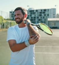 Image of Tennis Player with Sore Elbow