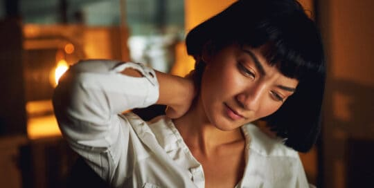 Image of Woman with Neck Pain